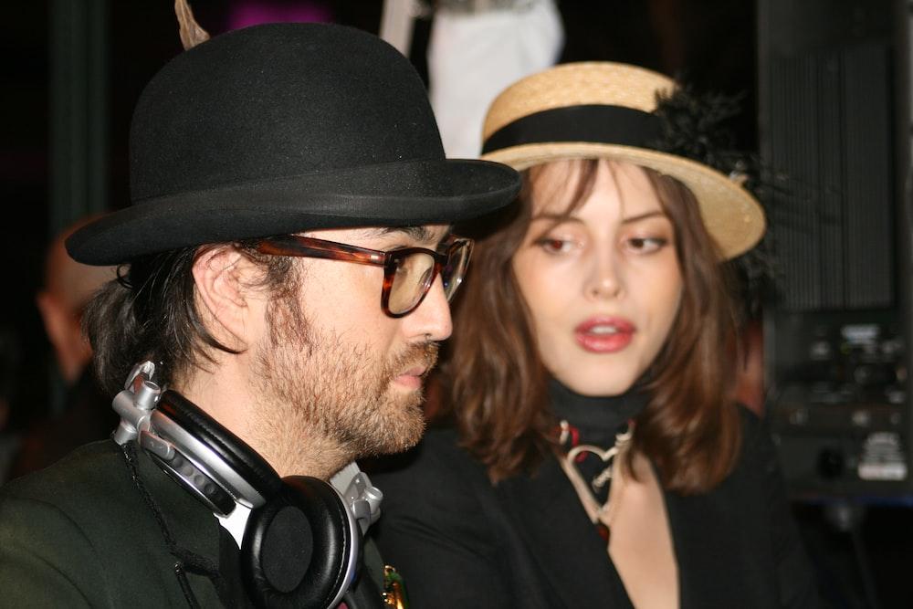 man in black shirt beside woman in black shirt