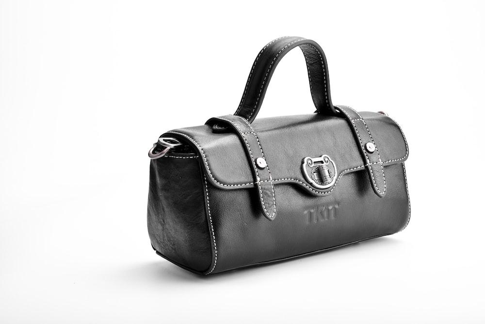 brown leather handbag on white table