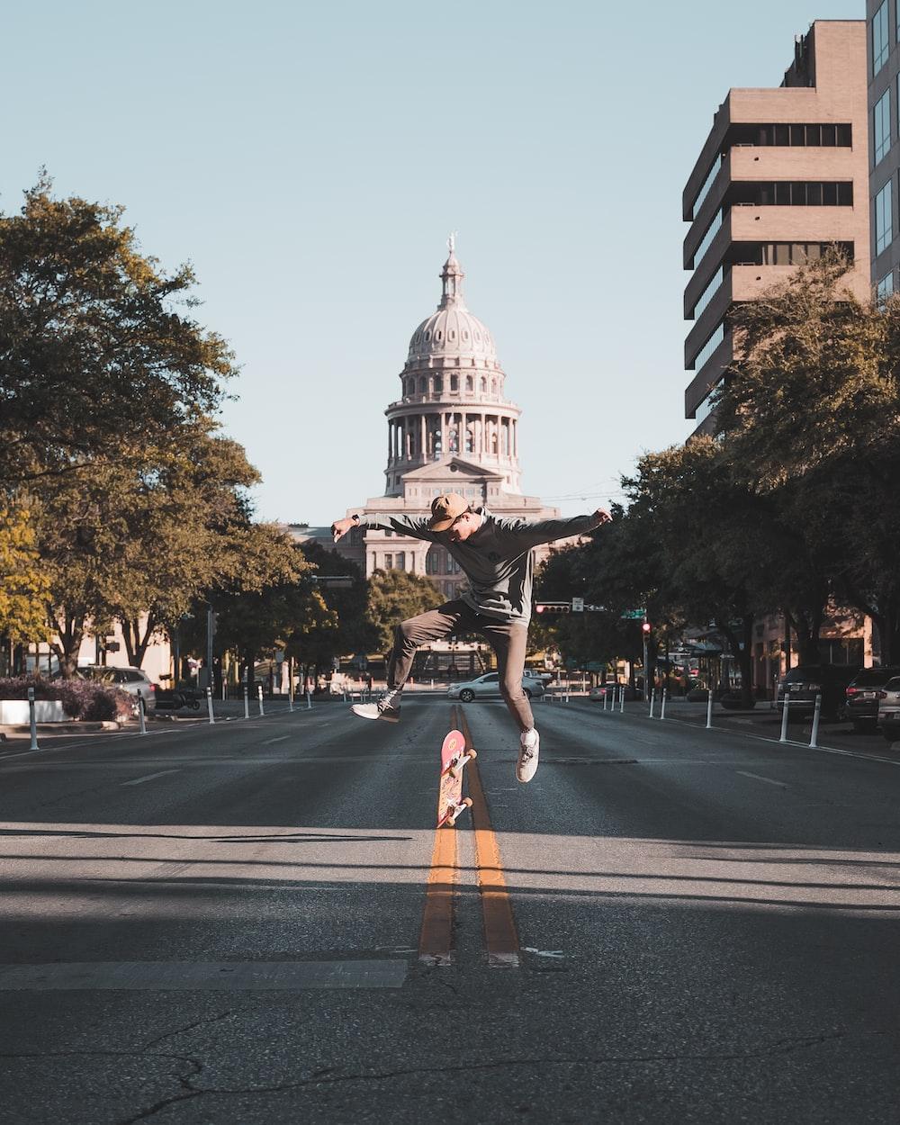 woman in black and white dress walking on pedestrian lane during daytime
