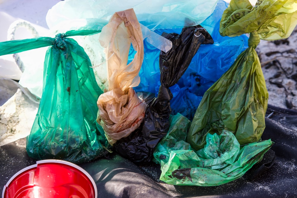 green plastic bags on the floor