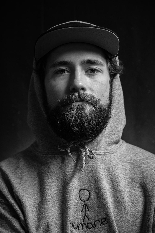 man in gray hoodie wearing black hat
