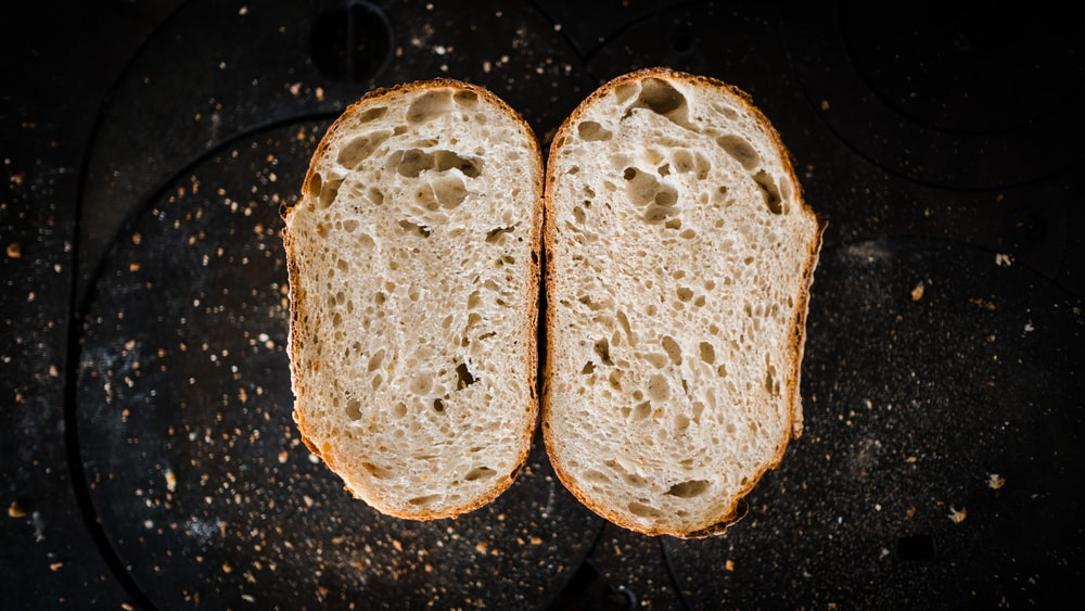 brown bread on black surface