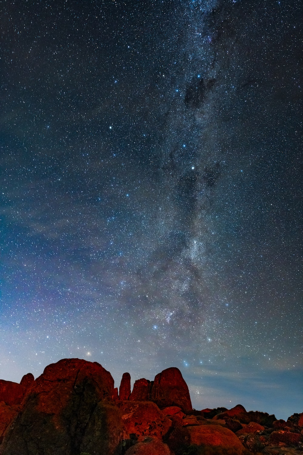 silhouette of mountain under starry night