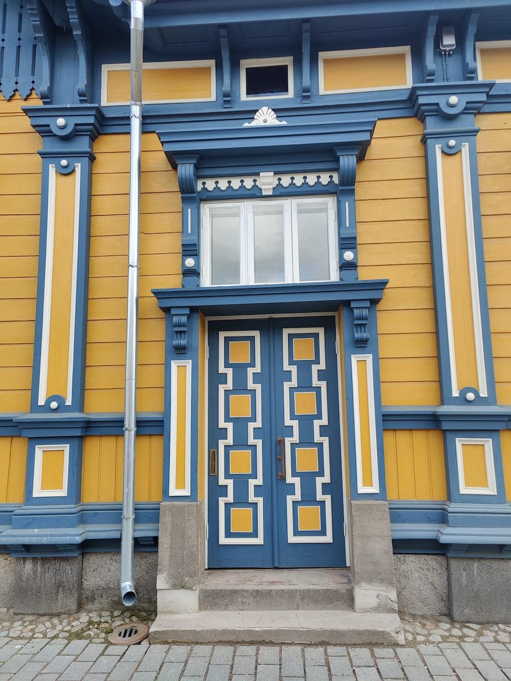 black and yellow wooden door