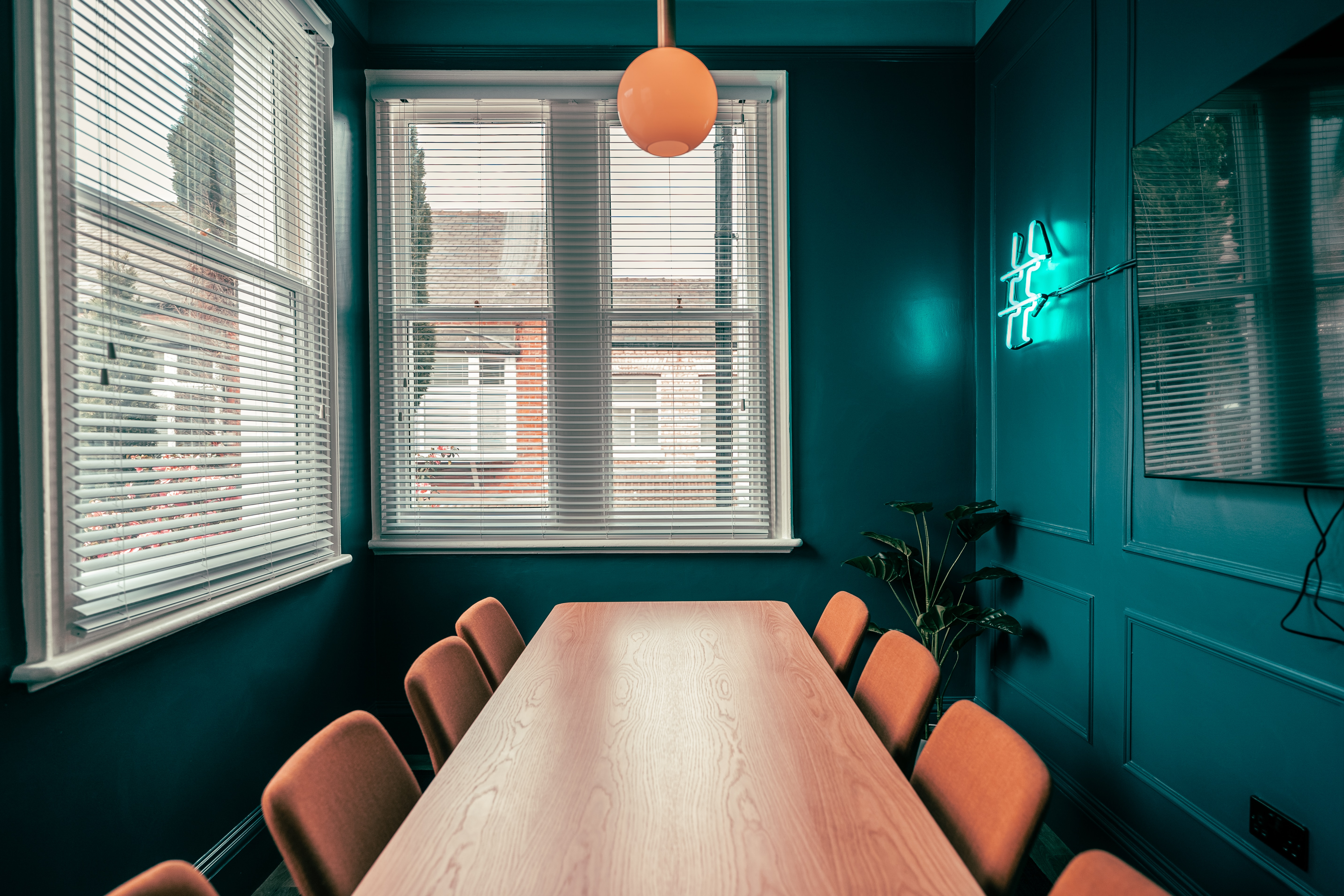 blue office brown wooden table with chairs