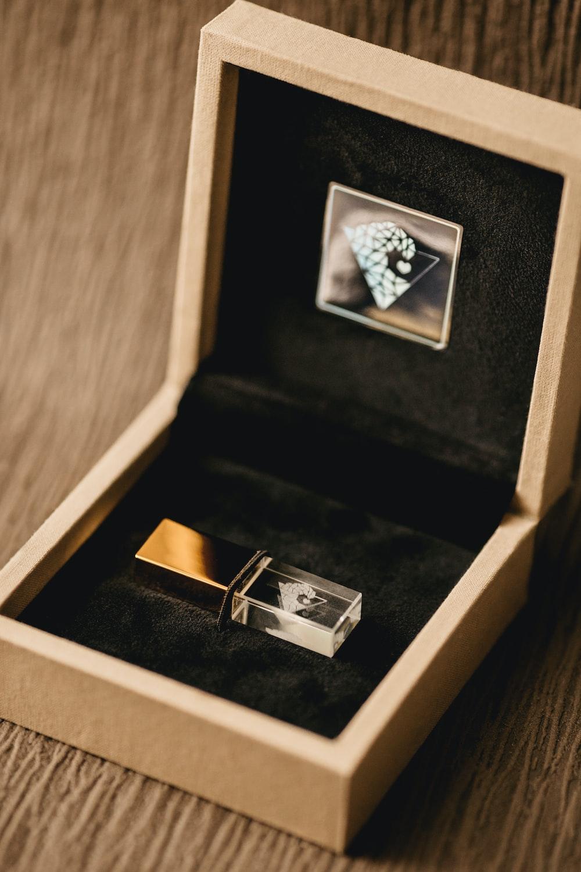 silver diamond ring in box