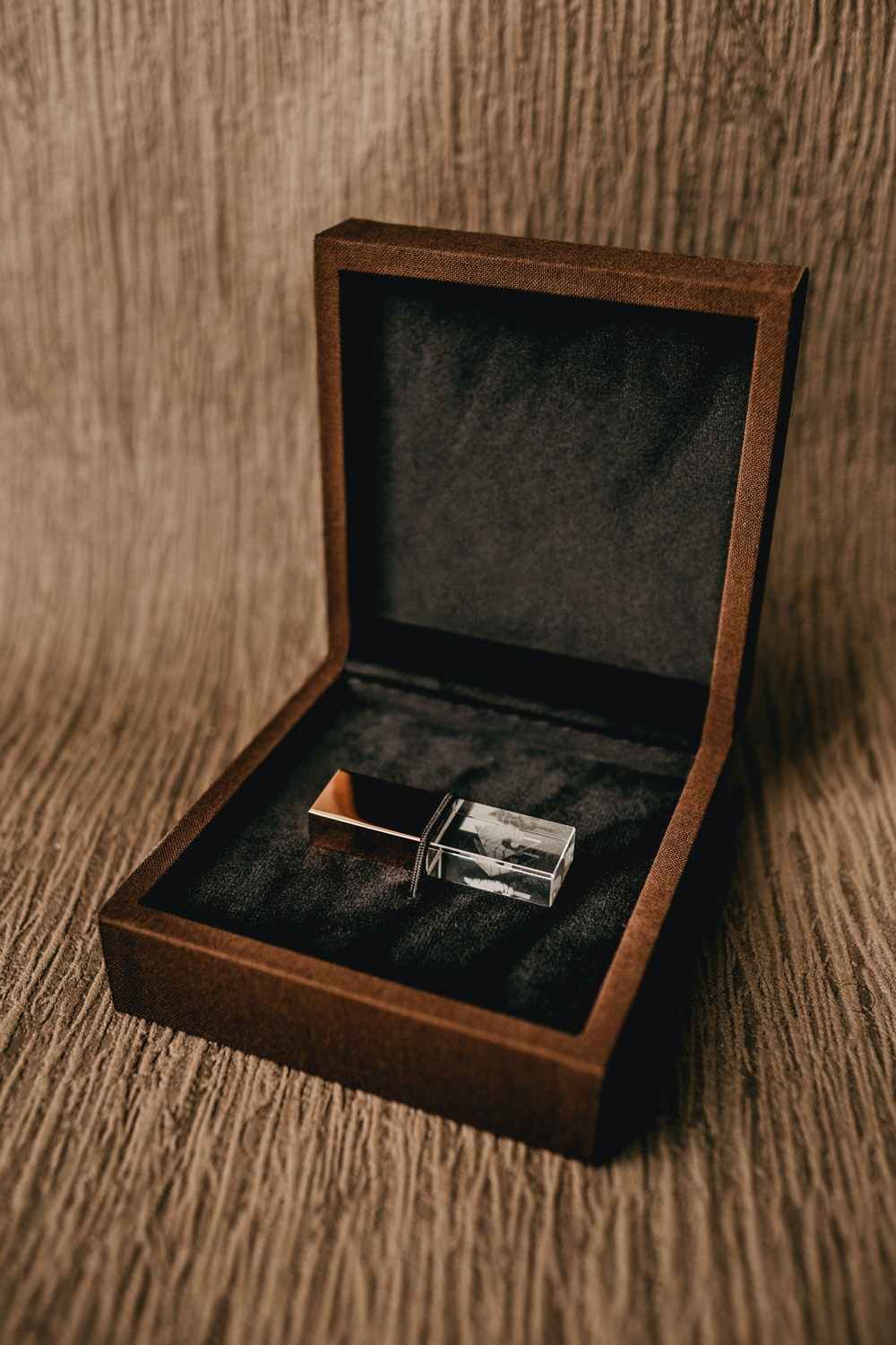 silver ring in brown box