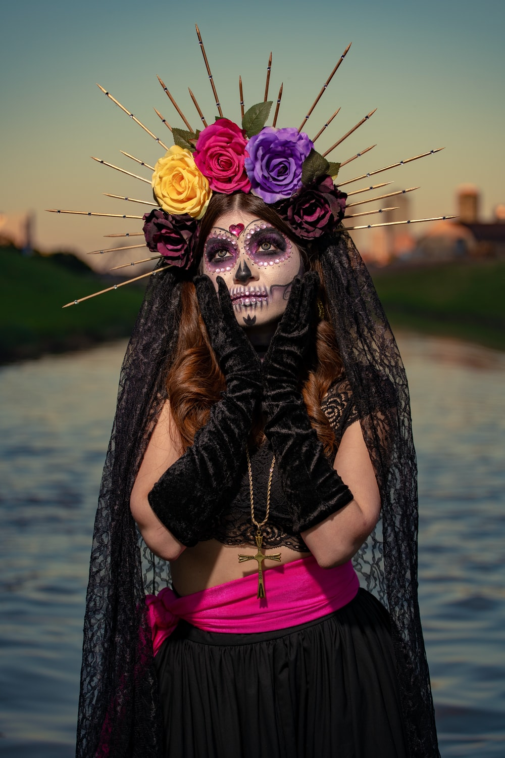 woman in black and pink long sleeve dress wearing black and purple feather headdress