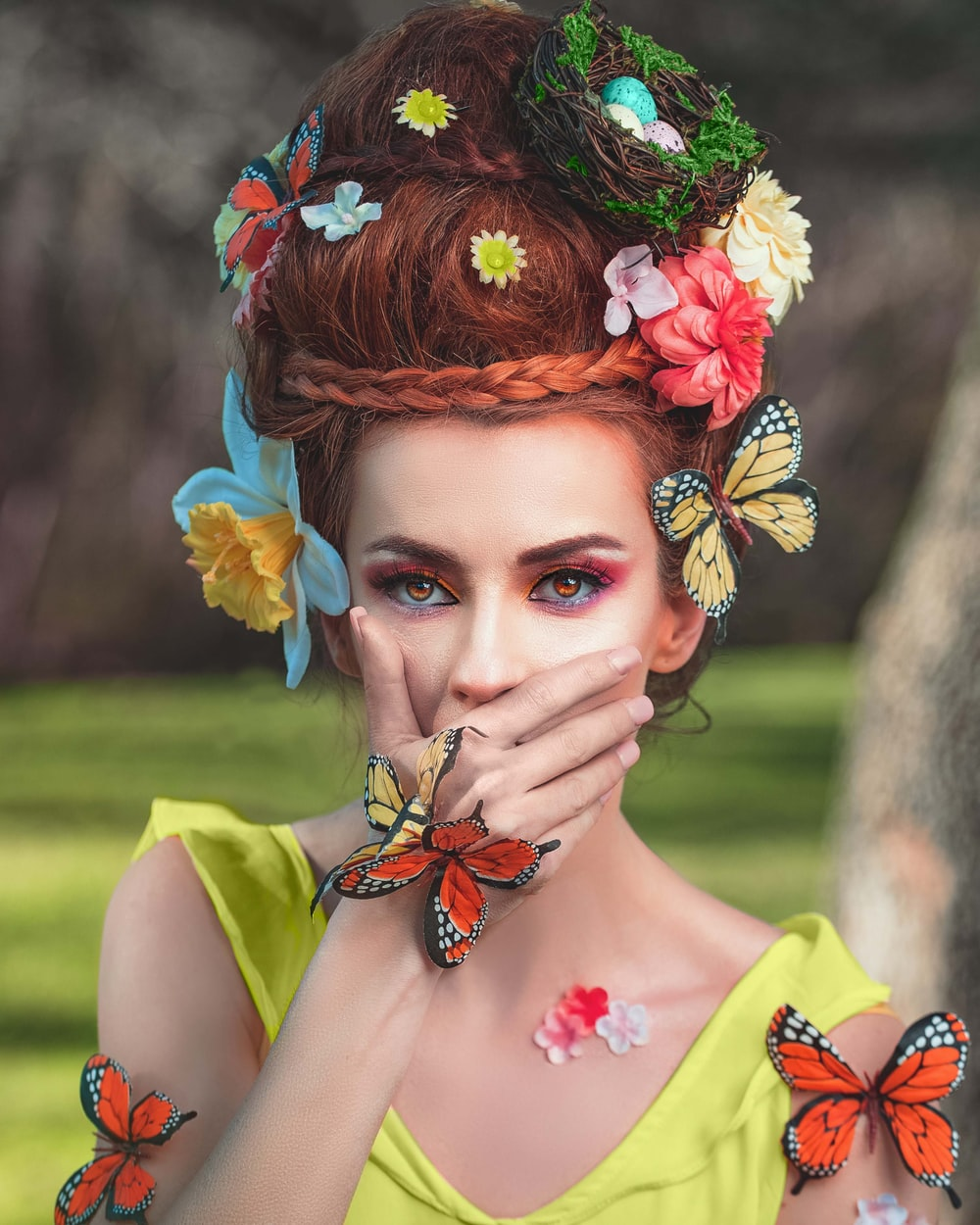 woman in yellow and red floral dress with orange flower headdress