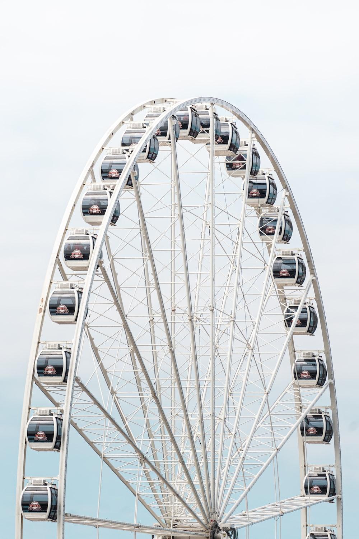 white ferris wheel under white sky during daytime