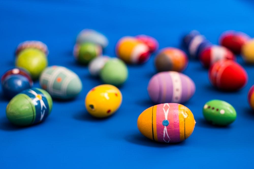 multi colored billiard balls on blue table