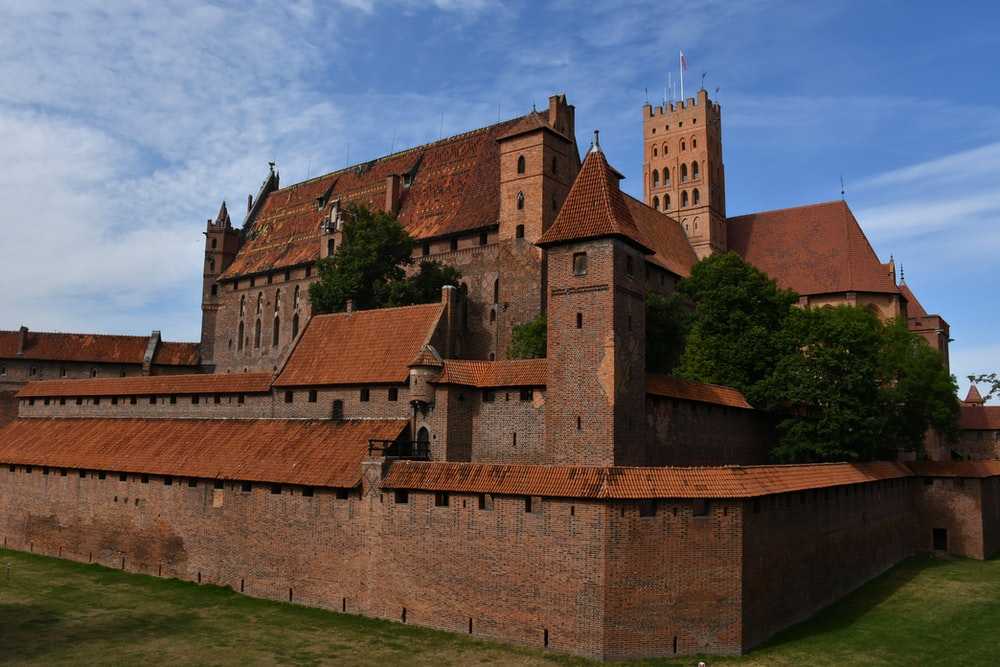 brown brick castle under blue sky during daytime