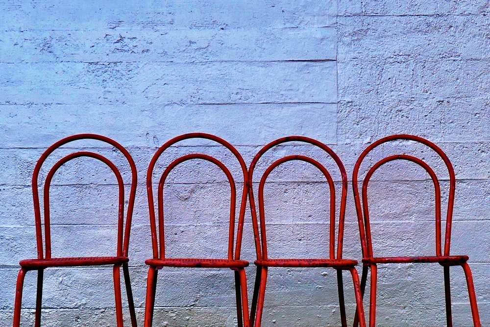 red metal frame on white concrete wall