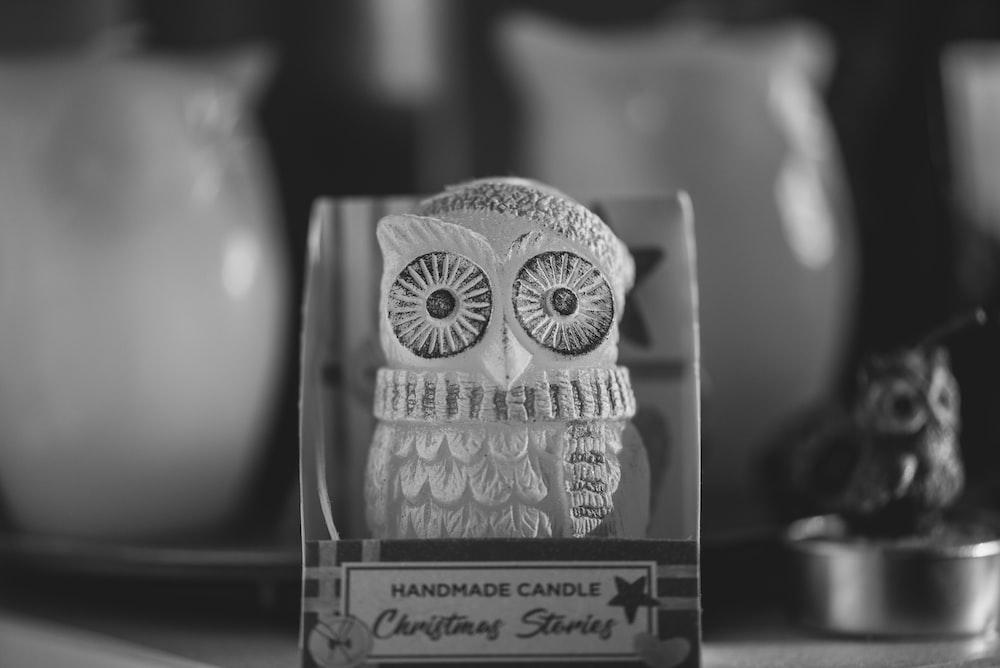 white and black owl ceramic figurine