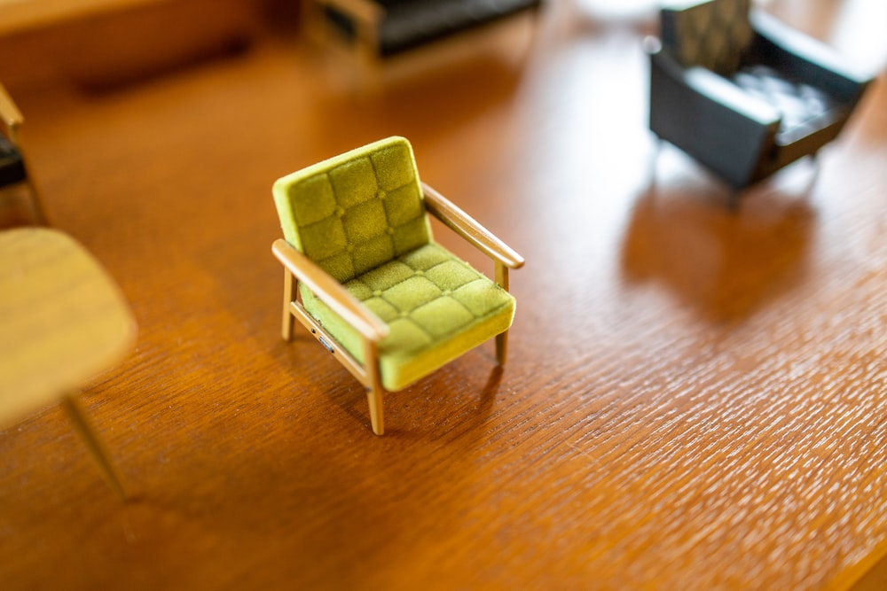 green wooden chair on brown wooden table