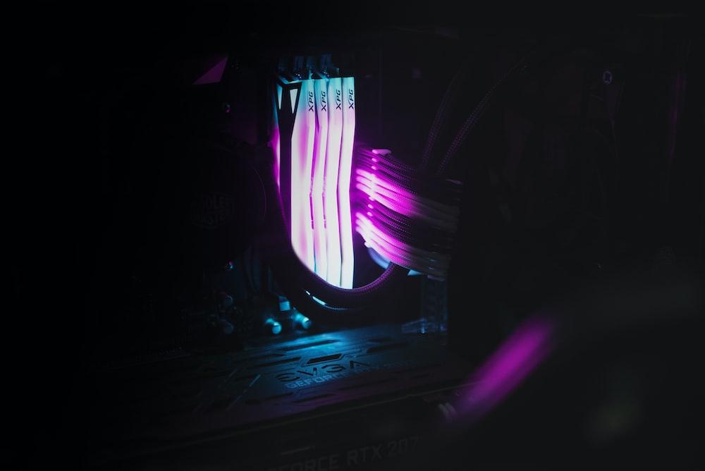 purple and blue light on a dark room