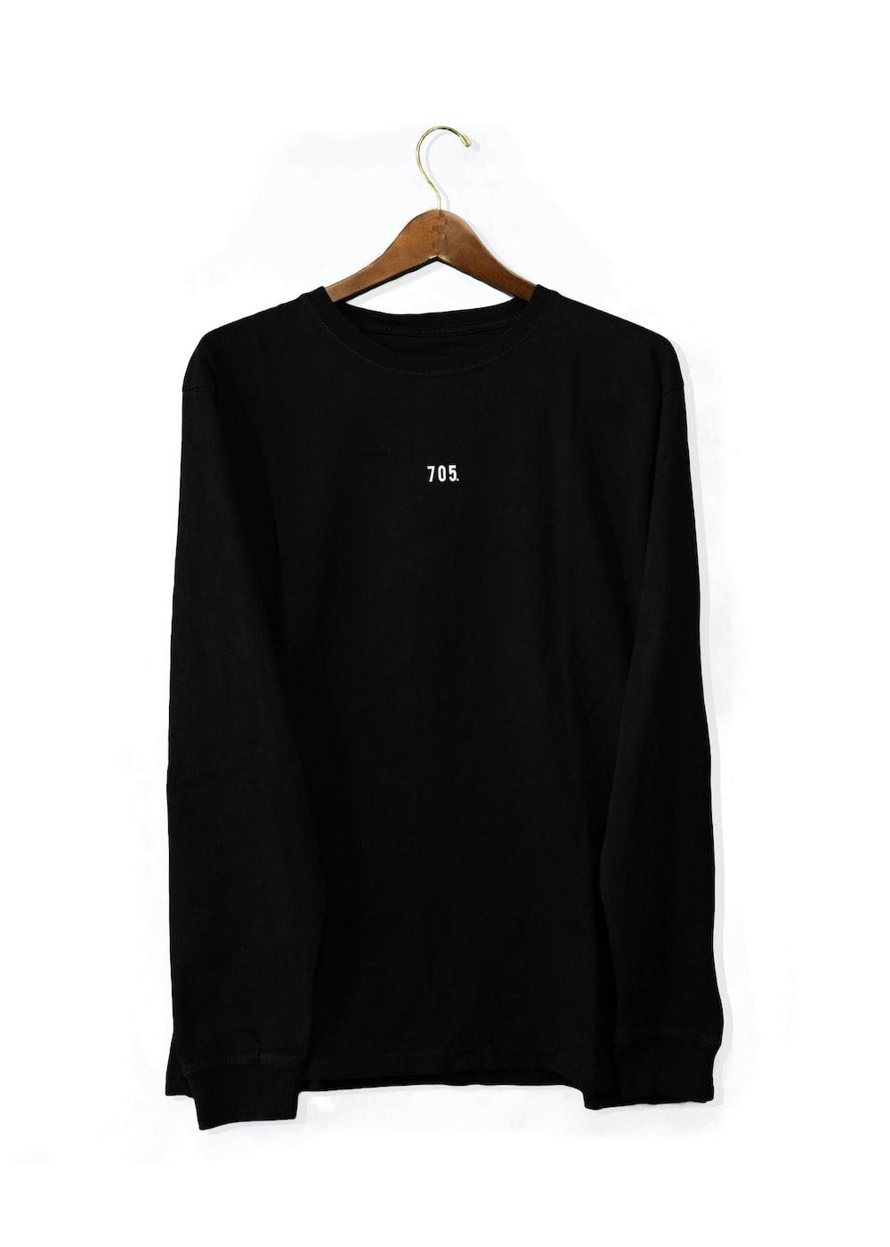 black long sleeve shirt on white table