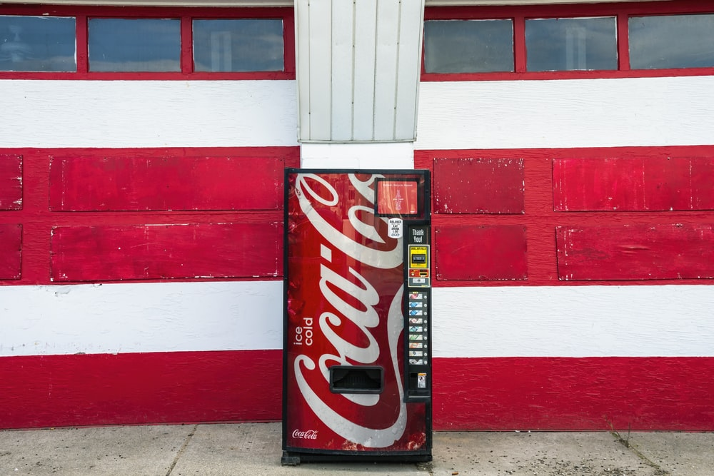 coca cola zero can on red and white wall