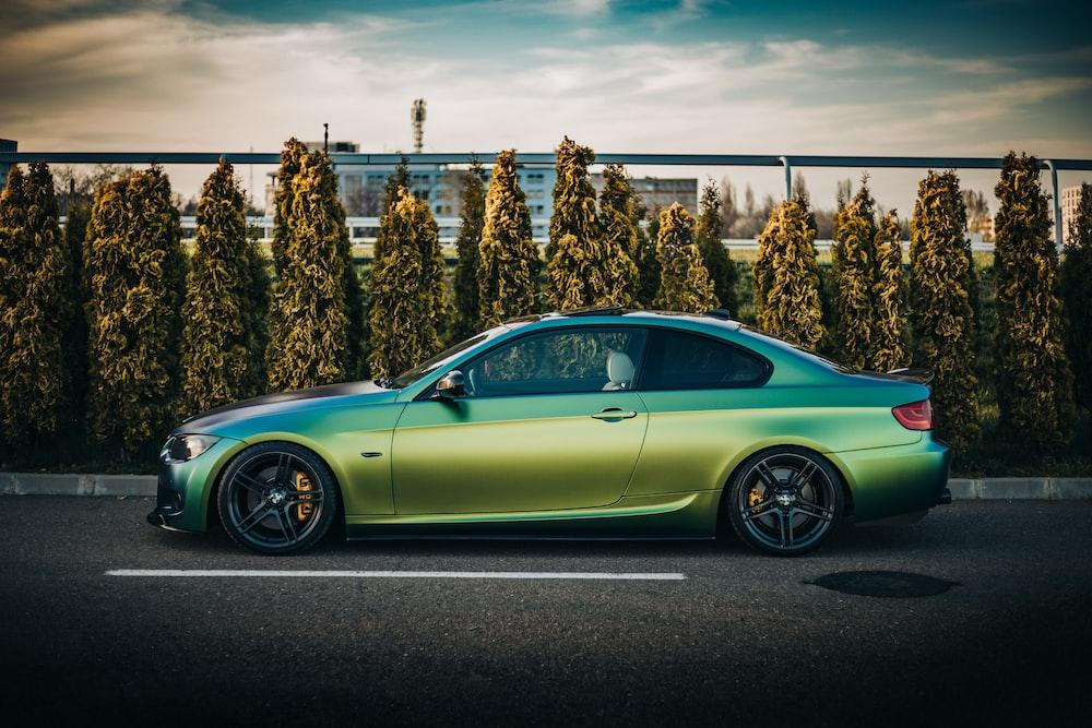 green porsche 911 parked on parking lot during daytime