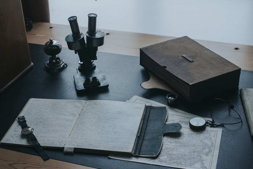 black and gray metal tool on black wooden table