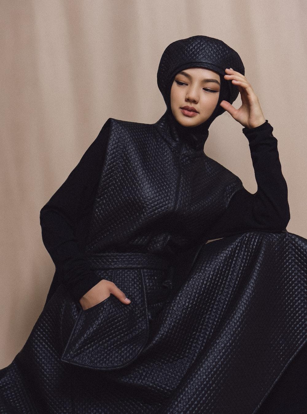 woman in black long sleeve dress and black hijab