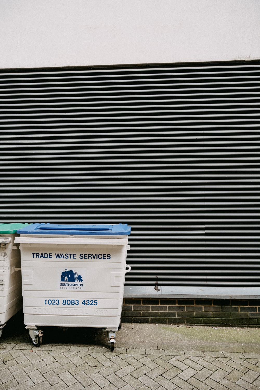 white and blue trash bin