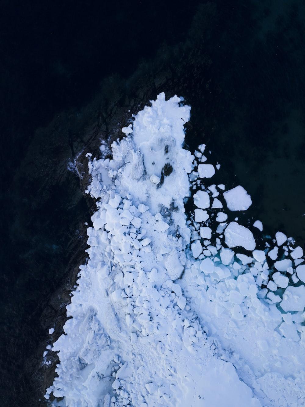 white snow on black surface
