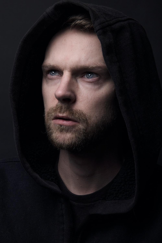 man in black hoodie jacket