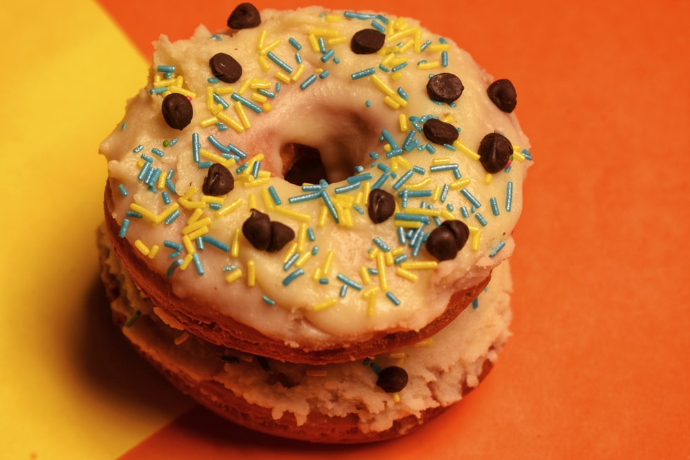 white and brown doughnut with sprinkles