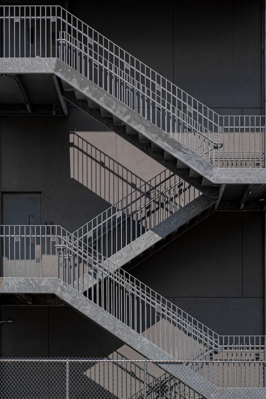 white metal staircase on gray concrete floor