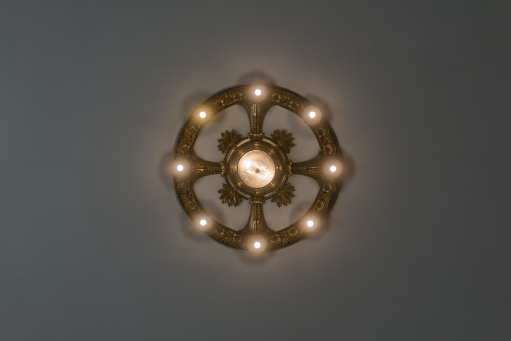 silver and gold round wall decor