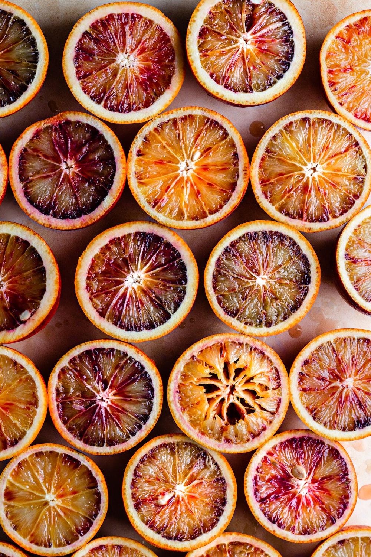 sliced orange fruit on black surface