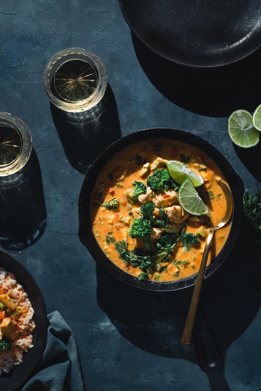 black ceramic bowl with soup