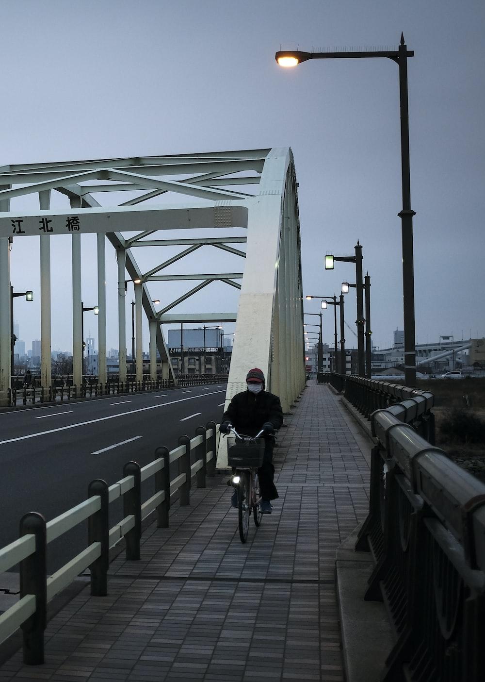 people walking on bridge during daytime