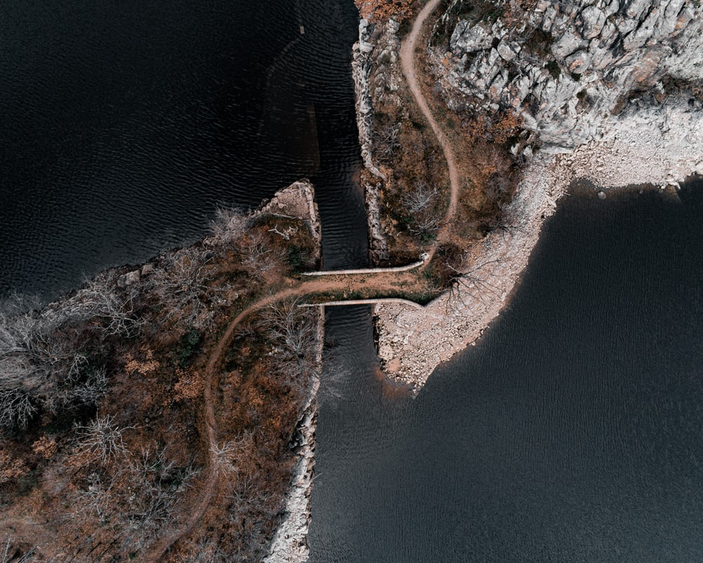 aerial view of brown wooden dock on body of water during daytime