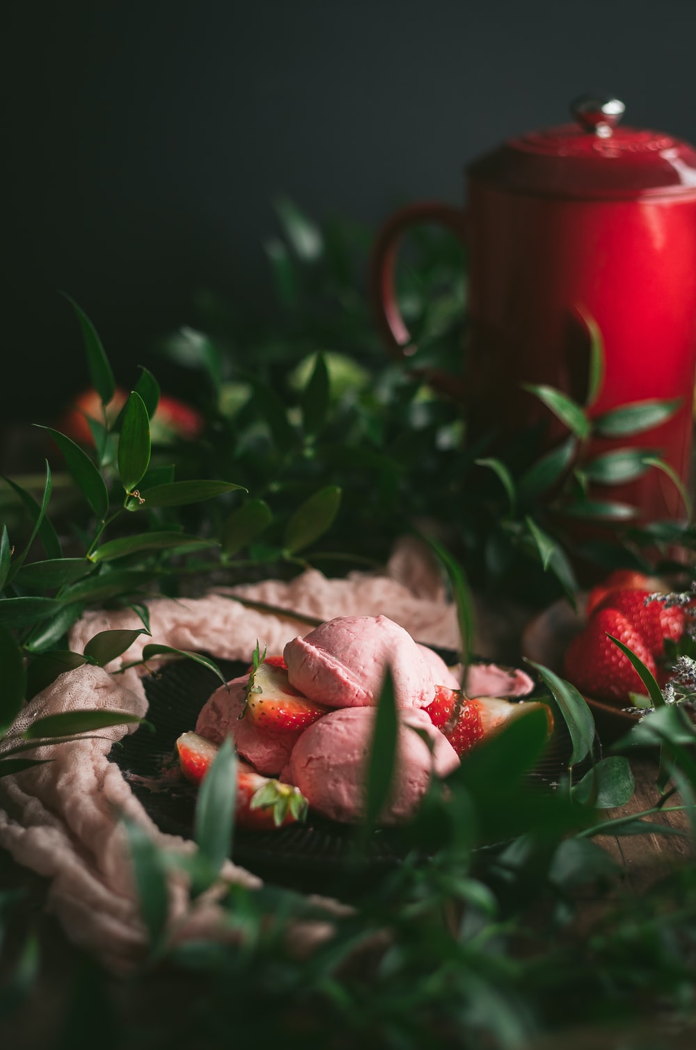 red strawberries on brown wooden table