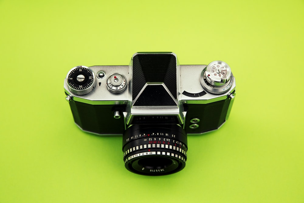 black and silver camera on green surface