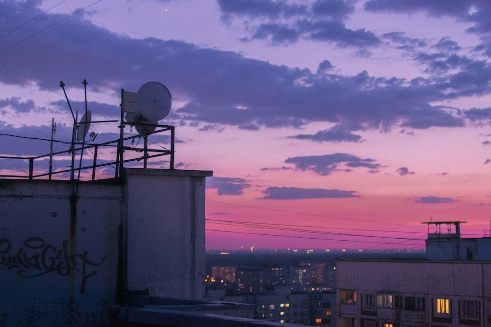 white satellite dish on white building during daytime