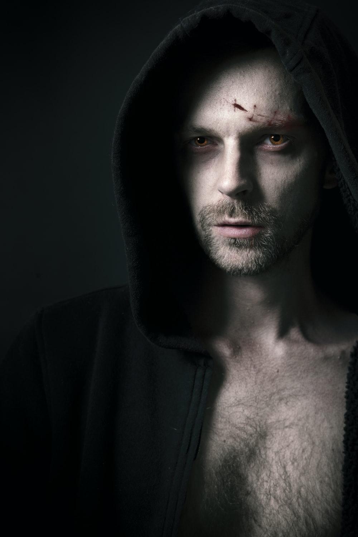 man in black hoodie with black beard