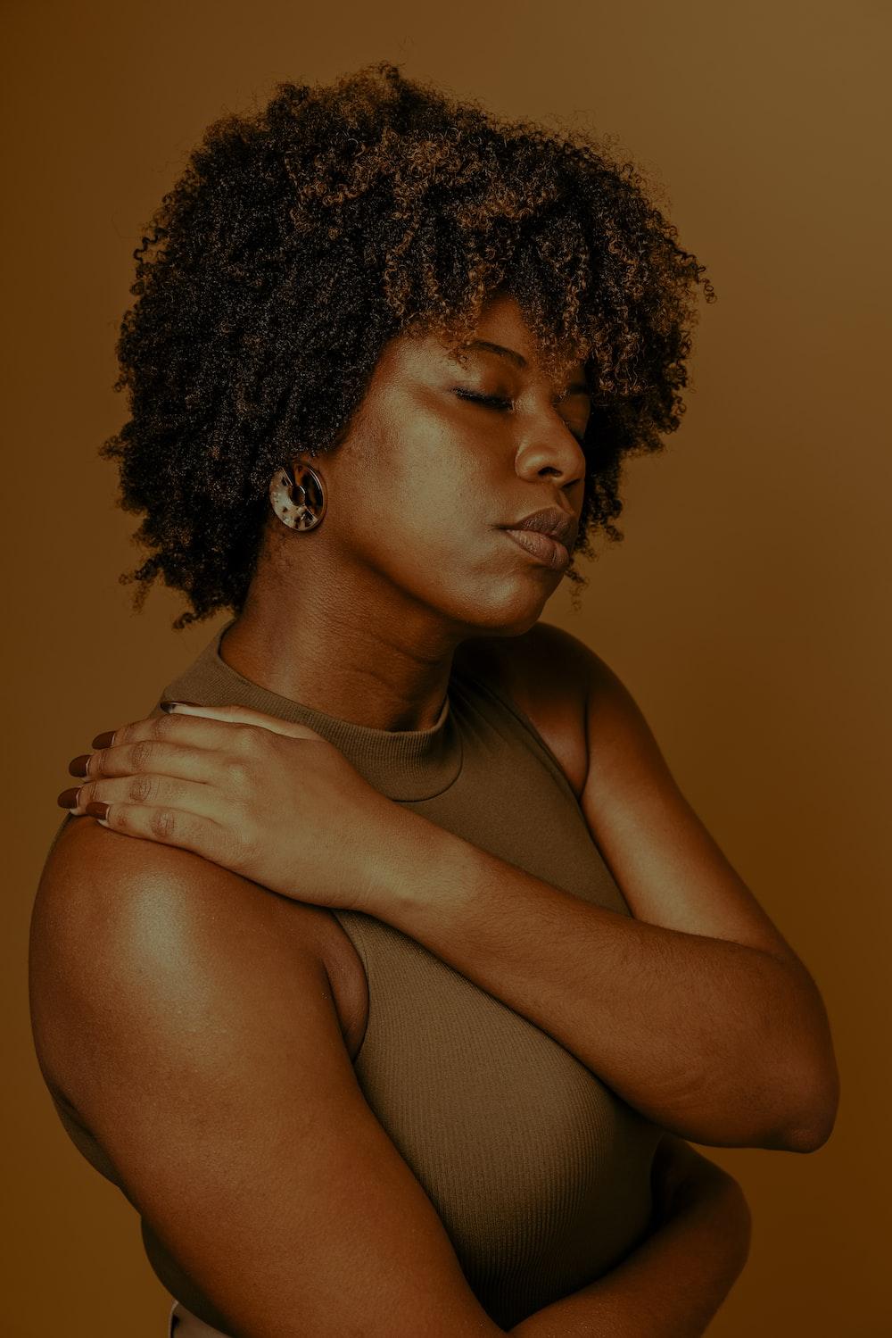 woman in brown tank top