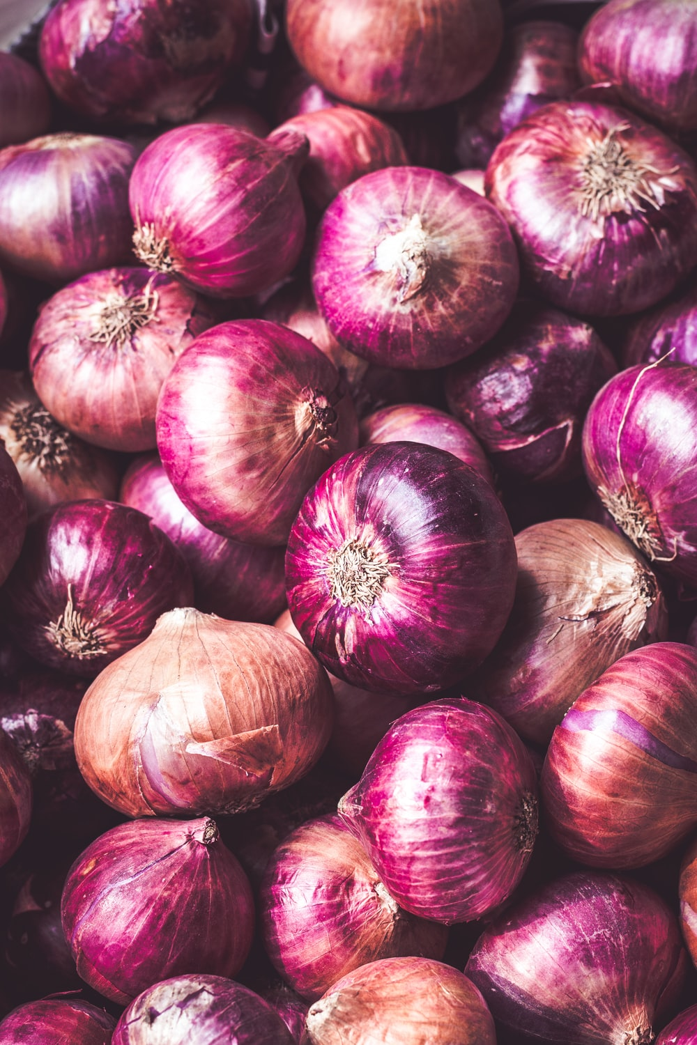red onion on brown wooden table