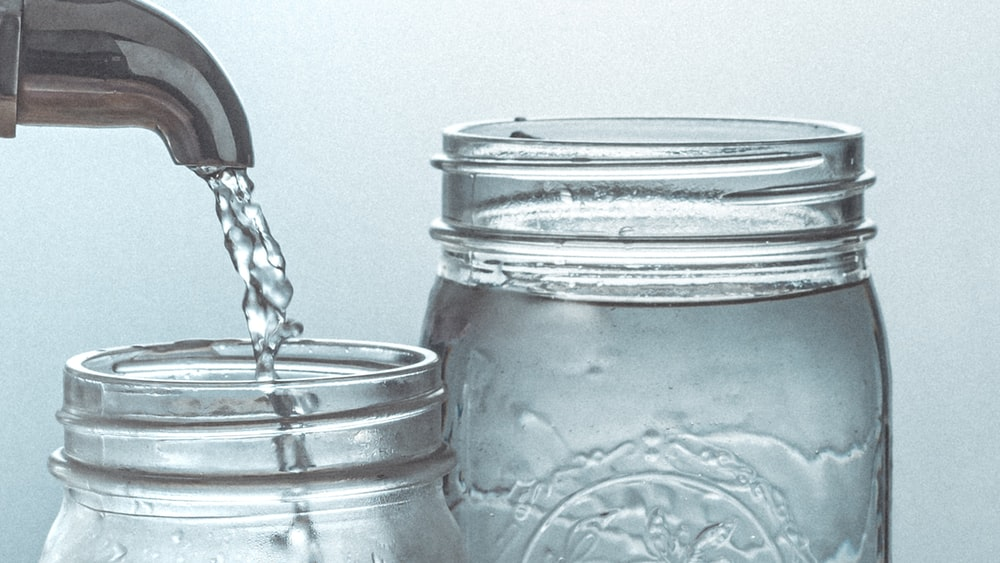 clear glass jar with water