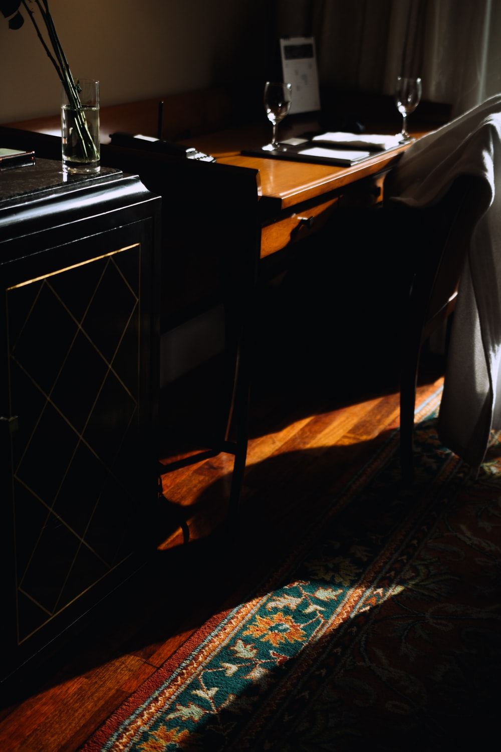 brown wooden table on black and white checkered floor