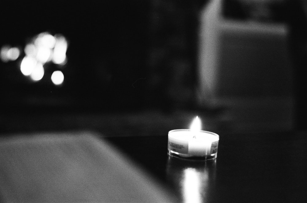 grayscale photo of lighted candle