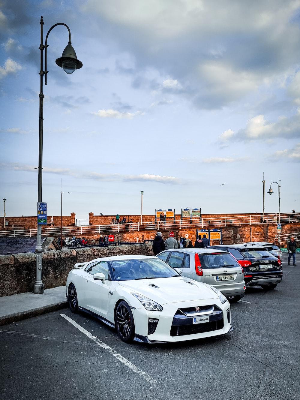 white sedan parked on parking lot during daytime