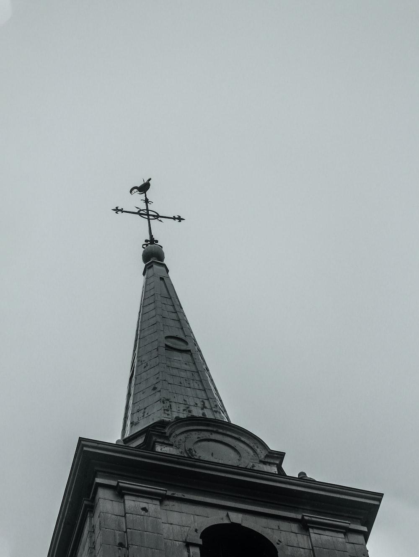 black cross on top of black tower