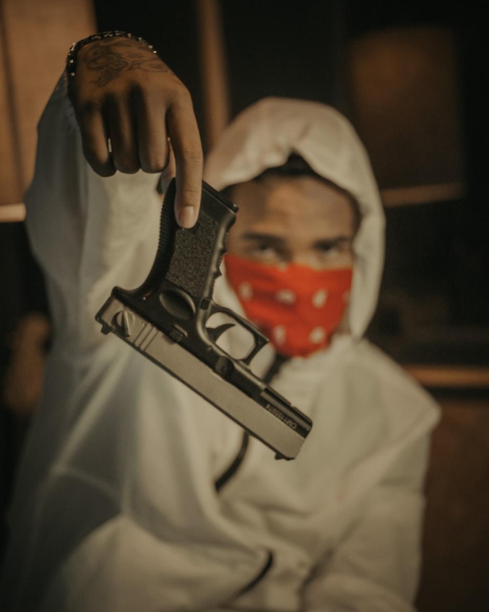 person holding black and silver semi automatic pistol