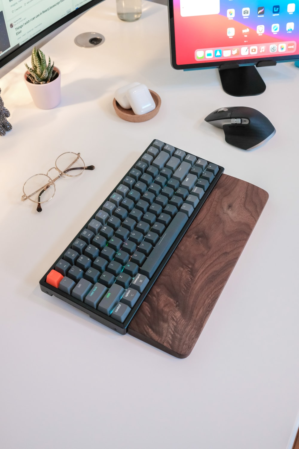 black and blue computer keyboard on brown wooden table