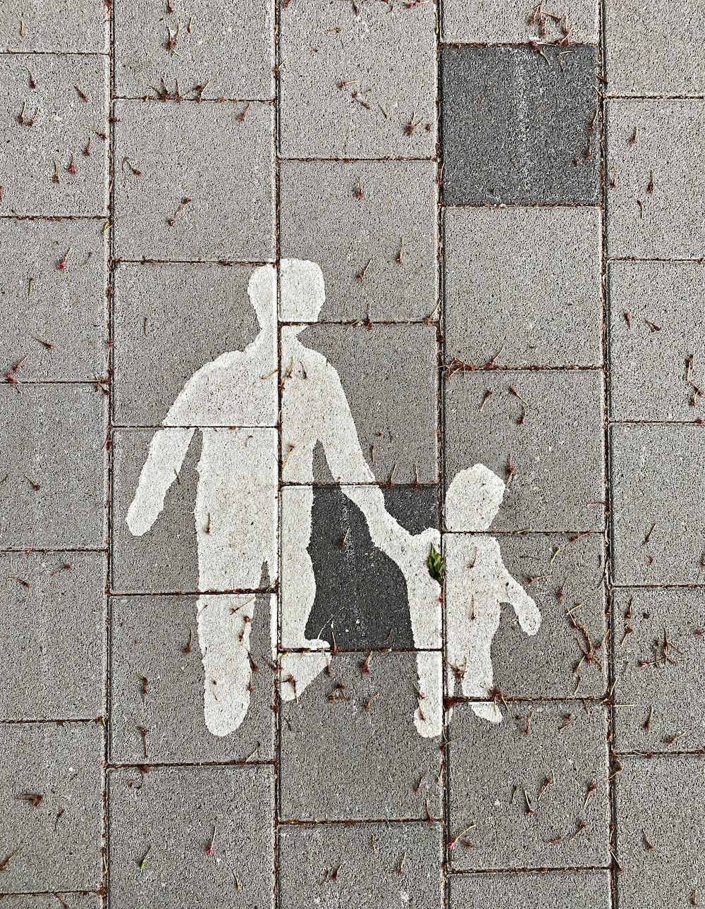 2 person walking on gray concrete pavement