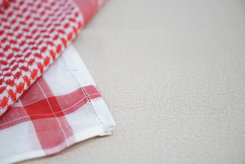 white and red checkered textile
